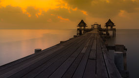 Dramatic shihouette sunset of wooden bridge Stock Photography