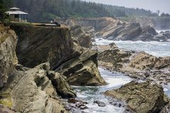 Dramatic shoreline with strange rock formations at Shore Acres State Park, Coos Bay, Oregon stock photography