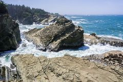 Dramatic shoreline with strange rock formations at Shores Acres State Park, Coos Bay, Oregon stock image