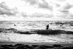 Dramatic shot of people bathing in Phu Quoc Island. Royalty Free Stock Images