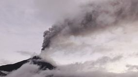 Dramatic Shot Of Tungurahua Volcano During 2016 Eruption Viewed Thru High Altitude Clouds stock footage