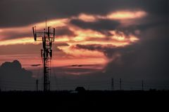 Dramatic Silhouette of Communication Tower. Stock Image