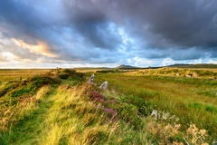 Dramatic Skies over Bodmin Moor. Dramatic sunset sky over King Arthur's Hall, a Neolithic monument made up of standing stones in a remote part of Bodmin Moor in Stock Images