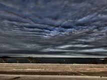 Dramatic skies over country field Stock Photography