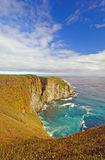 Dramatic Skies over ocean Cliffs Stock Image