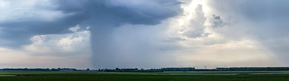 Thunderstorms over the island of Flakkee. Dramatic skies with thunderstorms are moving across the flat landscape of the island of Flakkee, The Netherlands royalty free stock photography