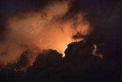 Dramatic Sky. Black clouds with sunlight illuminating from behind Royalty Free Stock Image