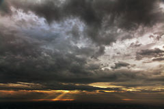 Dramatic sky. Of heavy gray clouds and sunbeams royalty free stock photography