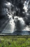 Dramatic sky. A break of light through a heavy sky Stock Image