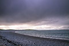 Dramatic sky above Cemlyn Bay, Anglesey in north Wales royalty free stock images