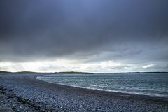 Dramatic sky above Cemlyn Bay, Anglesey in north Wales Stock Images