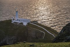 Dramatic sky above the historic South Stack Lighthouse - Isle of Anglesey North wales UK Royalty Free Stock Photo
