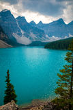 Dramatic sky above Moraine lake in Banff, Canada Stock Photos