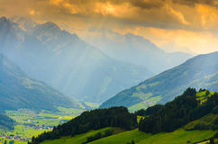 Dramatic sky in the alps. A very dramatic sky in the alps with the sun shining through the clouds Royalty Free Stock Photography