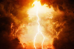 Dramatic sky. Apocalyptic dramatic background - bright lightning in dark red stormy sky, judgment day, hell stock photography