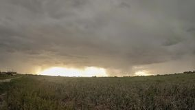 Ultra wide angle time lapse of an approaching thunderstorm over the dutch countryside. stock video