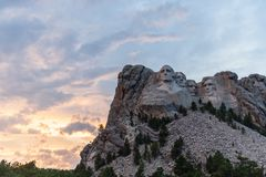 A dramatic Sky Behind Mount Rushmore. A dramatically colorful sky developing around sunset behind the four US presidents of Mount Rushmore, in North Dakota royalty free stock images