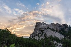 A dramatic Sky Behind Mount Rushmore. A dramatically colorful sky developing around sunset behind the four US presidents of Mount Rushmore, in North Dakota royalty free stock image