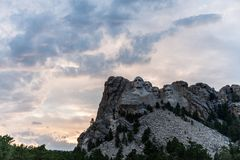 A dramatic Sky Behind Mount Rushmore. A dramatically colorful sky developing around sunset behind the four US presidents of Mount Rushmore, in North Dakota stock images