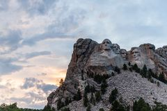 A dramatic Sky Behind Mount Rushmore. A dramatically colorful sky developing around sunset behind the four US presidents of Mount Rushmore, in North Dakota royalty free stock photo