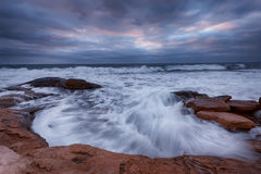 Dramatic sky, big waves, cloudscape just before the storm near the shore Stock Photography