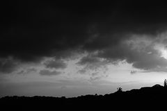 DRAMATIC SKY IN BLACK AND WHITE. Dramatic black and white sunset with dark clouds Stock Photo