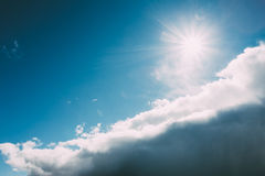 Dramatic Sky, Blue And White Colors. Sun Shine Over Fluffy Cloud Stock Image