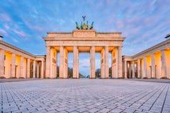Dramatic sky with Brandenburg gate in Berlin city, Germany stock image