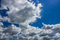 Dramatic sky clouds. Dramatic white clouds over a deep blue sky stock image