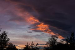Dramatic beautiful colored cloudy sky at sunset  royalty free stock image
