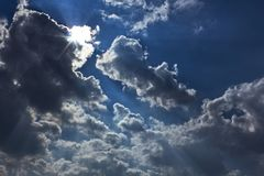 Dramatic sky clouds sun flares before thunder royalty free stock image