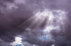 Dramatic sky cloudscape after thunderstorm with rays of sunlight Stock Images