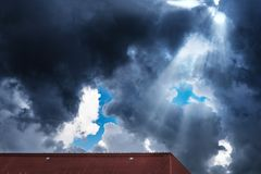 Dramatic sky cloudscape after thunderstorm with rays of sunlight Royalty Free Stock Image