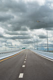 Dramatic sky and the concrete road. Royalty Free Stock Photos