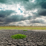 Dramatic sky and cracked earth Royalty Free Stock Image
