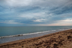Dramatic sky with cumulus clouds over the beach Royalty Free Stock Photos