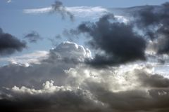 Dark clouds on the white clouds background Stock Photo