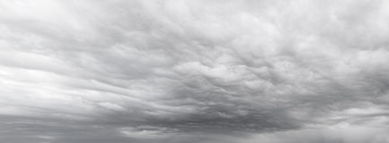 Dramatic sky. Dark ominous grey storm clouds stock images