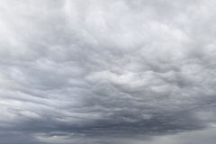 Dramatic sky. Dark ominous grey storm clouds stock photography