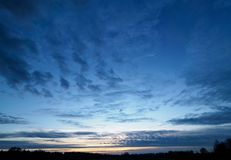 Dramatic Sky at Dusk High Resolution. Dramatic Sky at Dusk on golden/blue hour High Resolution stock photo