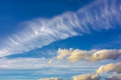 Dramatic sky with dynamic cloud arrangement. Cloudy weather background Royalty Free Stock Image