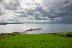 Dramatic Sky at the Irish Coast. Rainy weather over the irish coast stock photo