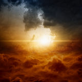 Dramatic sky. Dramatic nature background - bright sun in dark stormy sky stock photo