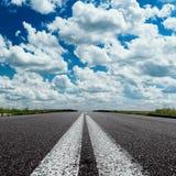 Dramatic sky over asphalt road Stock Photos
