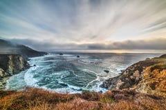 Dramatic sky over Big Sur coastline Stock Photos