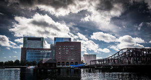 Dramatic sky over bridge and buildings in Boston, Massachusetts. Stock Photos