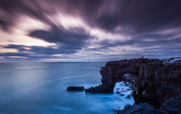 Dramatic sky over cliffs in Atlantic ocean Royalty Free Stock Images