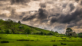 Dramatic sky over countryside. English farm on springtime in Forest of Bowland, Lancashire, England UK Stock Images
