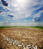 Dramatic sky over cracked earth Royalty Free Stock Photo