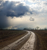 Dramatic sky over dirty road Stock Photo